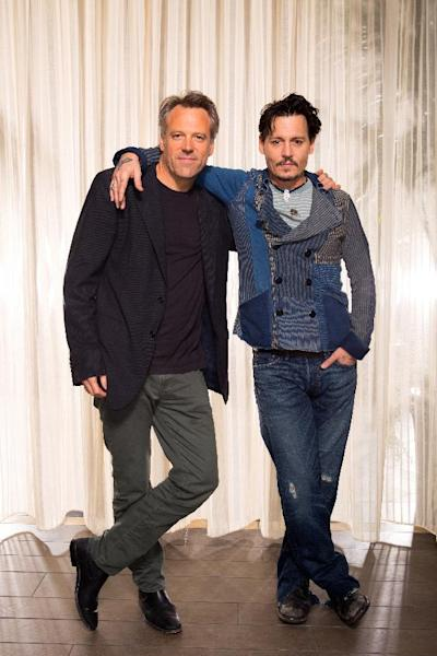 "This Saturday, April 5, 2014 photo shows actor Johnny Depp, right, and director Walter Pfister during the ""Transcendence"" film press junket at the Four Seasons Hotel, in Los Angeles. The film releases in the U.S. on April 18, 2014. (Photo by Zach Cordner/Invision/AP)"
