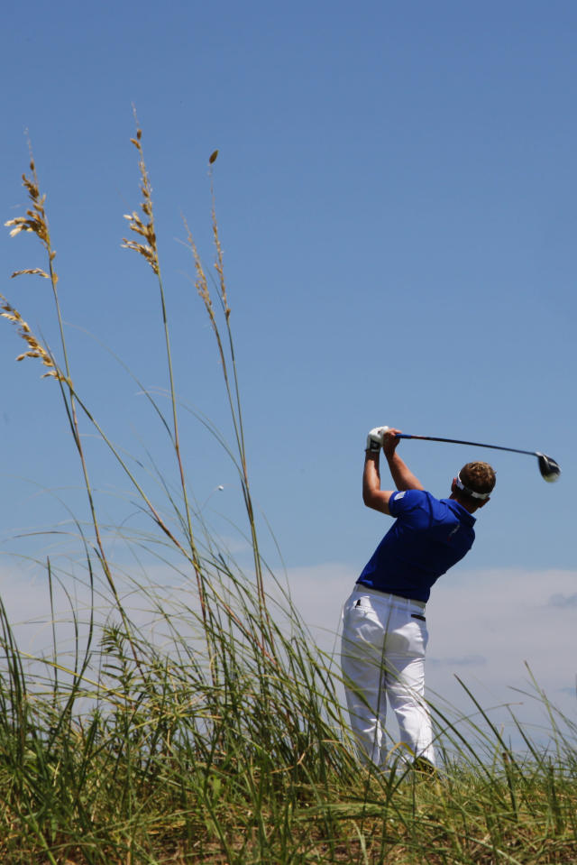 Luke Donald, of England, hits from the fourth tee during the first round of the PGA Championship golf tournament on the Ocean Course of the Kiawah Island Golf Resort in Kiawah Island, S.C., Thursday, Aug. 9, 2012. (AP Photo/Chuck Burton)