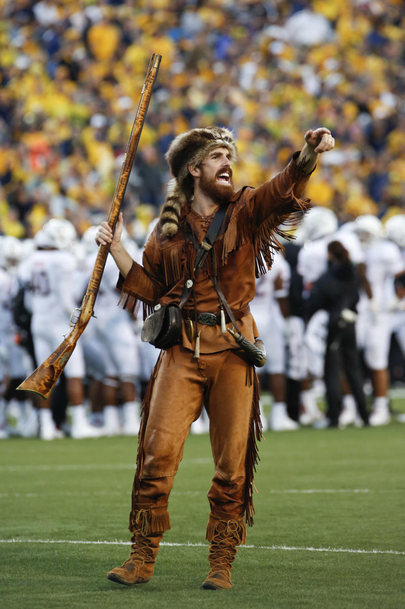 FILE This Saturday Sept. 22, 2012 file photo shows West Virginia University Mountaineer mascot Jonathan Kimble is seen during the NCAA college football game between West Virginia University and University of Maryland in Morgantown, W.Va. A video showing Kimble using his mascot rifle to hunt bear has gone viral.   (AP Photo/Brian Ach)