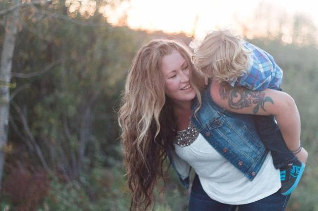 Ashley Ames shown with her son.  (Brittany Hunter/This Life Photography - image credit)