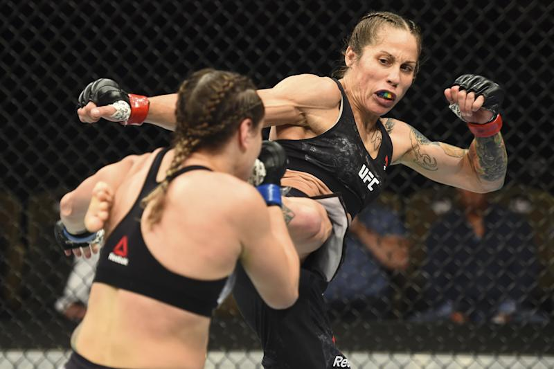BOISE, ID - JULY 14: (R-L) Liz Carmouche kicks Jennifer Maia of Brazil in their women's flyweight fight during the UFC Fight Night event inside CenturyLink Arena on July 14, 2018 in Boise, Idaho. (Photo by Josh Hedges/Zuffa LLC/Zuffa LLC via Getty Images)