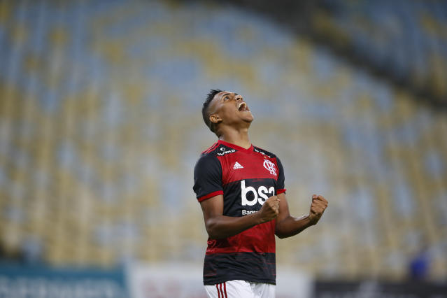 Flamengo's Pedro Rocha celebrates after scoring during a Rio de Janeiro soccer league match against Bangu at the Maracana stadium in Rio de Janeiro, Brazi, Thursday, June 18, 2020. Rio de Janeiro's soccer league resumed after a three-month hiatus because of the coronavirus pandemic. The match is being played without spectators to curb the spread of COVID-19. (AP Photo/Leo Correa)