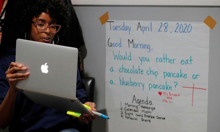 "<span class=""element-image__caption"">Boston Public School teacher Princess Bryant teaches her kindergarten class online.</span> <span class=""element-image__credit"">Photograph: Brian Snyder/Reuters</span>"