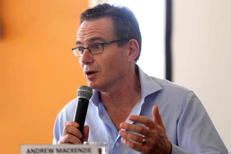 BHP Billiton CEO Andrew Mackenzie speaks during a press conference in Mariana on November 11, 2015 (AFP Photo/Cristiane Mattos)