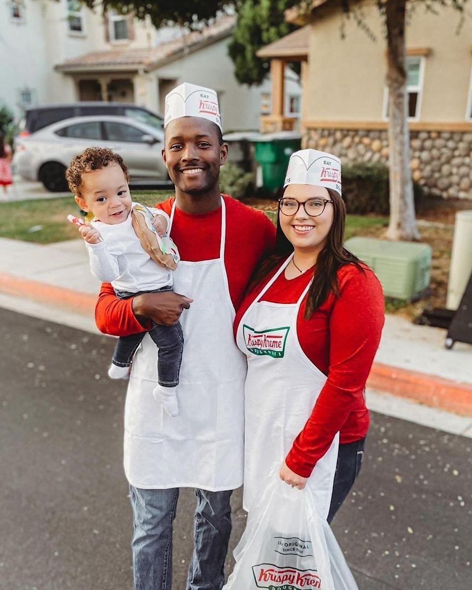 """<p>We <em>dough-nut</em> like thinking we've missed out on this sweet and easy costume idea all these years! Don the shop's aprons and caps, then let your little one be the sweet treat.</p><p><strong>See more at <a href=""""https://www.instagram.com/p/CHCC5Gyl9nB/"""" rel=""""nofollow noopener"""" target=""""_blank"""" data-ylk=""""slk:@taylorowalton"""" class=""""link rapid-noclick-resp"""">@taylorowalton</a>.</strong> </p>"""