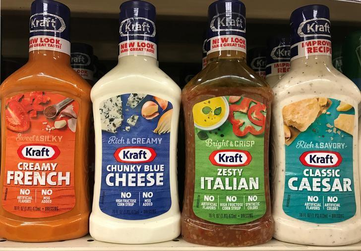 Bottles of salad dressing made by food conglomerate Kraft Heinz are seen on a supermarket shelf in Seattle