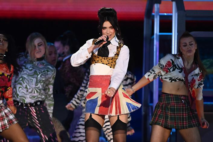 And, the Union Jack stayed even when the blazer was off – revealing her third and final look of the night.