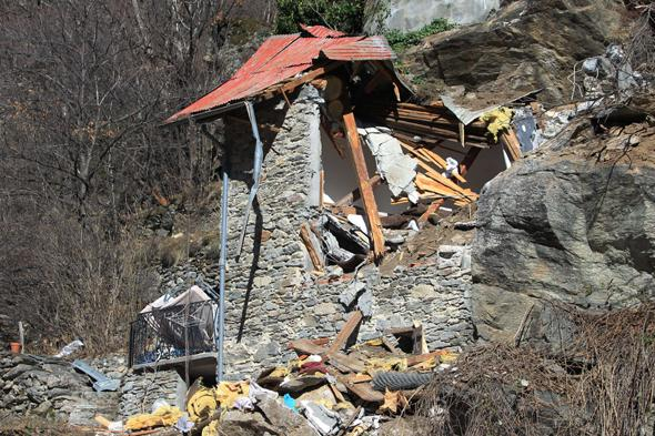 A picture taken on February 23, 2014 in Isola Village (French Alps), shows the site of the mountain cottage destroyed by a rockslide which killed two children aged seven and ten. Both children and their families from the region, arrived yesterday in the village where they occupied an old barn located on a cliff.AFP PHOTO / JEAN CHRISTOPHE MAGNENET        (Photo credit should read JEAN CHRISTOPHE MAGNENET/AFP/Getty Images)