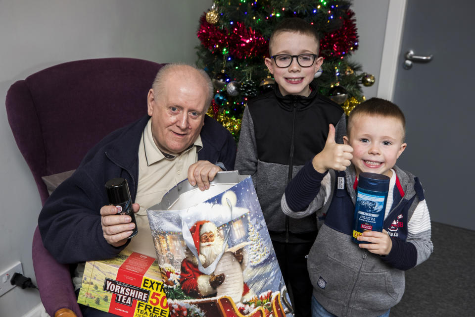 John Stevenson holds his presents given to him by Lewis (Liam McBurney/PA)