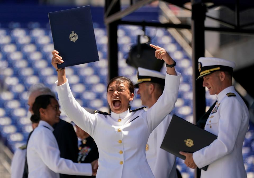 A graduate celebrates after receiving her diploma during the U.S. Naval Academy's Class of 2019 graduation and commissioning ceremony at the U.S. Naval Academy in Annapolis, Maryland, U.S., May 24, 2019.  REUTERS/Kevin Lamarque