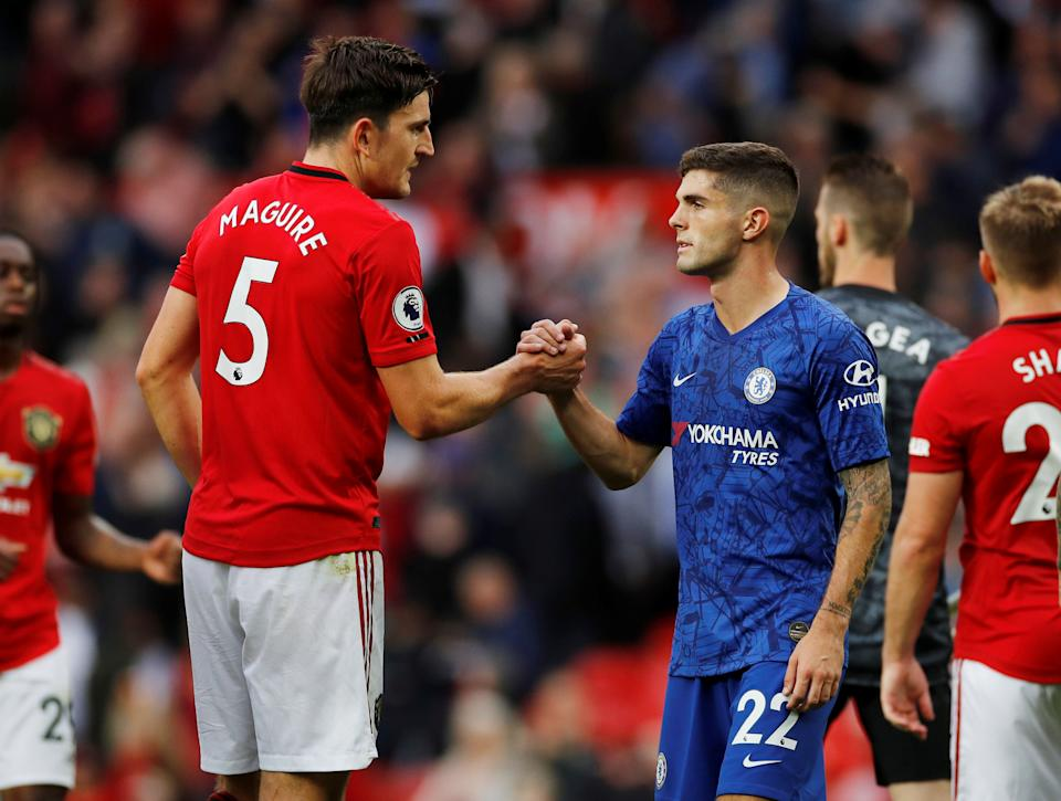 """Soccer Football - Premier League - Manchester United v Chelsea - Old Trafford, Manchester, Britain - August 11, 2019  Chelsea's Christian Pulisic and Manchester United's Harry Maguire shake hands at the end of the match  REUTERS/Phil Noble  EDITORIAL USE ONLY. No use with unauthorized audio, video, data, fixture lists, club/league logos or """"live"""" services. Online in-match use limited to 75 images, no video emulation. No use in betting, games or single club/league/player publications.  Please contact your account representative for further details."""