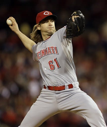 Cincinnati Reds starting pitcher Bronson Arroyo throws during the first inning of a baseball game against the St. Louis Cardinals, Monday, Oct. 1, 2012, in St. Louis. (AP Photo/Jeff Roberson)