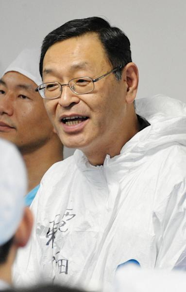 In this Nov. 12, 2011 photo, former chief of Japan's crippled nuclear power plant, Masao Yoshida, speaks at the Tokyo Electric Power Co Fukushima Dai-ichi nuclear power plant in Okuma town, Fukushima Prefecture, northeastern Japan. Yoshida, who led efforts to stabilize the Fukushima Dai-ichi nuclear power plant, after it was hit by the March 11, 2011, earthquake and tsunami, died Tuesday morning, July 9, 2013, at a Tokyo hospital, said TEPCO spokesman Yoshimi Hitosugi. He was 58. (AP Photo/Kyodo News) JAPAN OUT, MANDATORY CREDIT