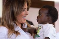 TOPSHOT - US First Lady Melania Trump (L) holds a baby as she visits the Nest Childrens Home Orphanage in Nairobi, on October 5, 2018, which primarily cares for children whose parents have been incarcerated. (Photo by SAUL LOEB / AFP) (Photo credit should read SAUL LOEB/AFP via Getty Images)