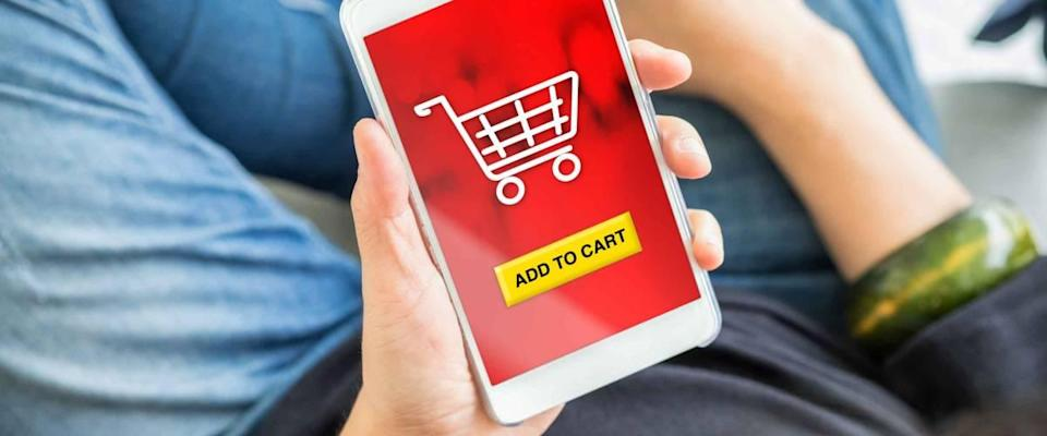 add to cart button on mobile screen with woman holding mobile phone buy online shopping item with apps,digital marketing concept.