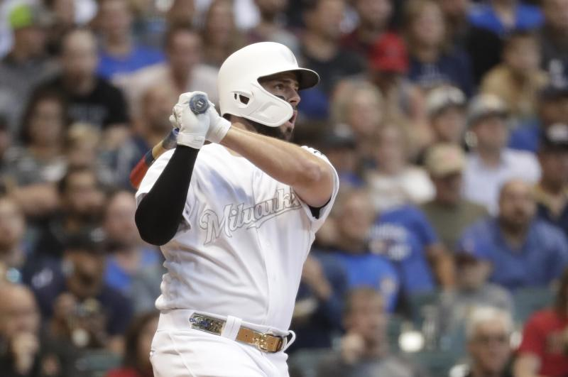 Milwaukee Brewers' Mike Moustakas hits a two-run scoring double during the first inning of a baseball game against the Arizona Diamondbacks Friday, Aug. 23, 2019, in Milwaukee. (AP Photo/Morry Gash)