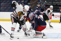 Columbus Blue Jackets' Joonas Korpisalo, right, makes a save against Chicago Blackhawks' Patrick Kane during the first period of an NHL hockey game Thursday, Feb. 25, 2021, in Columbus, Ohio. (AP Photo/Jay LaPrete)