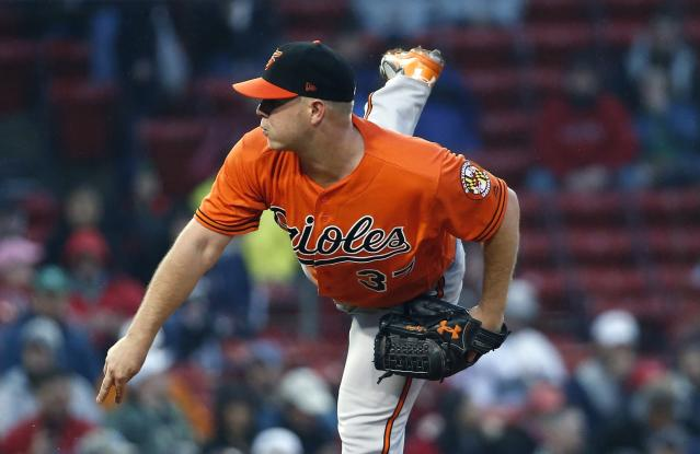 Baltimore Orioles' Dylan Bundy pitches during the first inning of a baseball game against the Boston Red Sox in Boston, Saturday, May 19, 2018. (AP Photo/Michael Dwyer)
