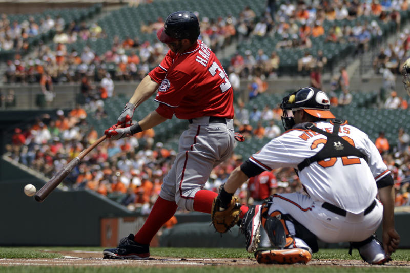Washington Nationals' Bryce Harper singles in the first inning of an interleague baseball game against the Baltimore Orioles in Baltimore, Sunday, June 24, 2012. (AP Photo/Patrick Semansky)