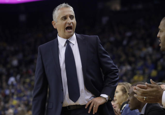 Phoenix Suns head coach Igor Kokoskov yells toward his bench during the first half of his team's NBA basketball game against the Golden State Warriors in Oakland, Calif., Sunday, March 10, 2019. (AP Photo/Jeff Chiu)