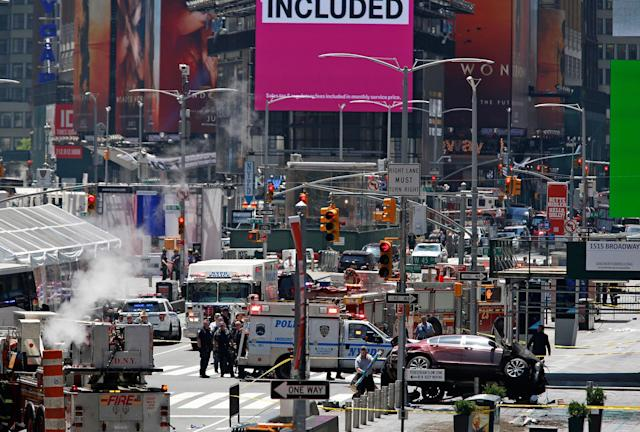 <p>A smashed car, lower right, sits on the corner of Broadway and 45th Street in New York's Times Square after ploughing through a crowd of pedestrians at lunchtime on Thursday, May 18, 2017. (AP Photo/Seth Wenig) </p>
