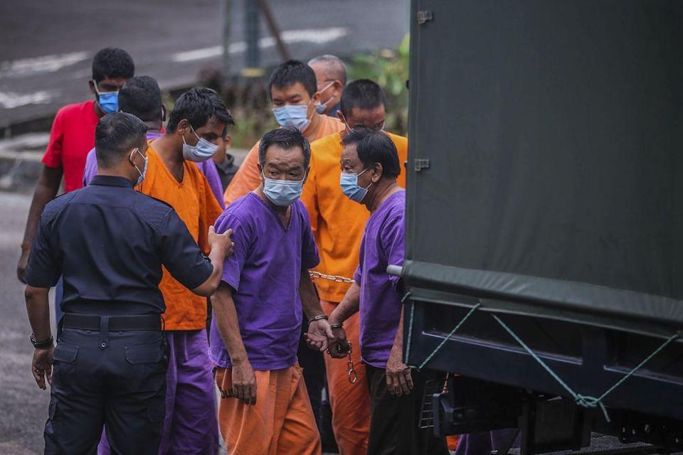 The suspects from a company allegedly responsible for Sungai Selangor's odour pollution arrive at the Selayang Magistrate's Court October 21, 2020. — Picture by Hari Anggara