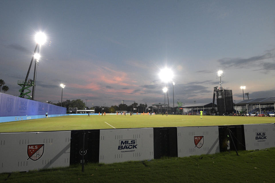 The Los Angeles FC compete against the Houston Dynamo during the first half of an MLS soccer match at the ESPN Wide World of Sports complex, Monday, July 13, 2020, in Kissimmee, Fla. (AP Photo/Phelan M. Ebenhack)