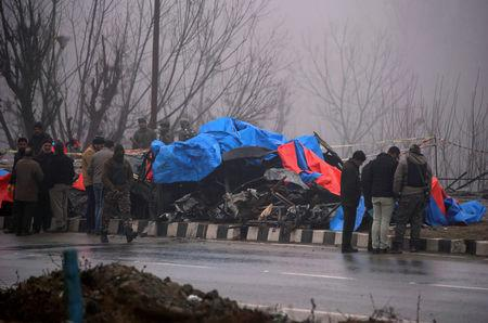 FILE PHOTO: Forensic officials inspect the wreckage of a bus after a suicide bomber rammed a car into the bus carrying Central Reserve Police Force (CRPF) personnel, in Lethpora in south Kashmir's Pulwama district, February 15, 2019. REUTERS/Danish Ismail/File Photo