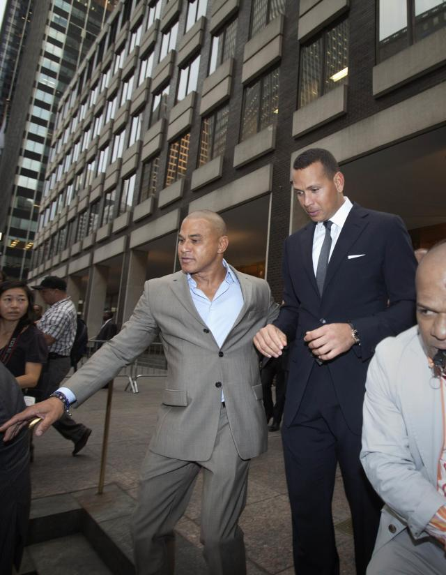 New York Yankees baseball player Alex Rodriguez leaves Major League Baseball's headquarters in New York, October 4, 2013. Yankees' Rodriguez has sued Major League Baseball (MLB) and Commissioner Bud Selig and accused them of trying to destroy his reputation and his career. MLB responded to the lawsuit by issuing their own statement, denying the allegations made by Rodriguez and accusing him of trying to circumvent the grievance process of the league and its players. REUTERS/Carlo Allegri (UNITED STATES - Tags: CRIME LAW DRUGS SOCIETY SPORT BASEBALL)