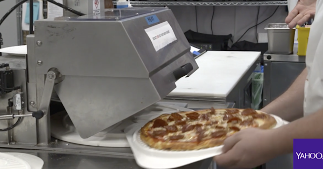 In half a second, this machine cuts the 14-inch pizza into 8 slices.