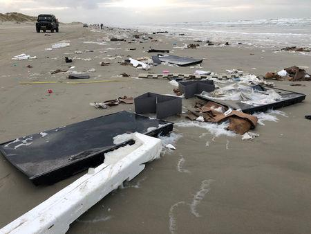 Flat-screen television sets and debris lie washed up on a beach in Terschelling, Netherlands January 2, 2019 in this image obtained from social media. Erik Scheer via REUTERS