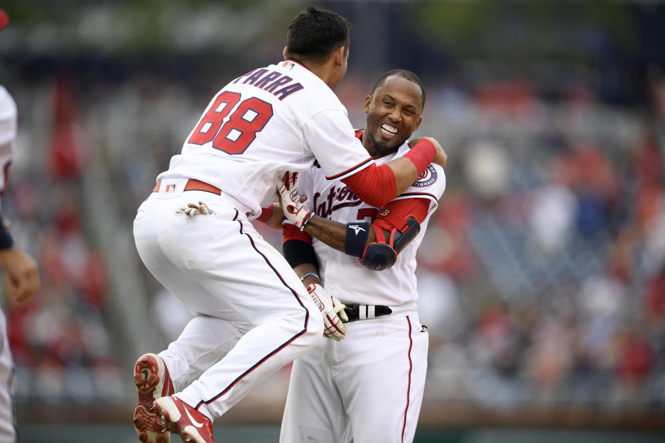Washington Nationals' Alcides Escobar, right, celebrates his walkoff single that scored Tres Barrera (not shown) with Gerardo Parra (88) during the ninth inning of a baseball game against the San Diego Padres, Sunday, July 18, 2021, in Washington. (AP Photo/Nick Wass)