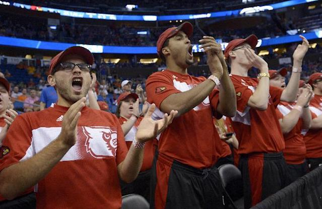 Louisville fans cheer during the first half in a third-round game in the NCAA college basketball tournament against Saint Louis, Saturday, March 22, 2014, in Orlando, Fla. (AP Photo/Phelan M. Ebenhack)