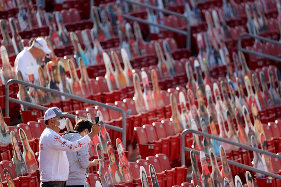 An attendee takes a photo before Super Bowl LV between the Tampa Bay Buccaneers and the Kansas City Chiefs at Raymond James Stadium on February 07, 2021 in Tampa, Florida. (Photo by Kevin C. Cox/Getty Images)