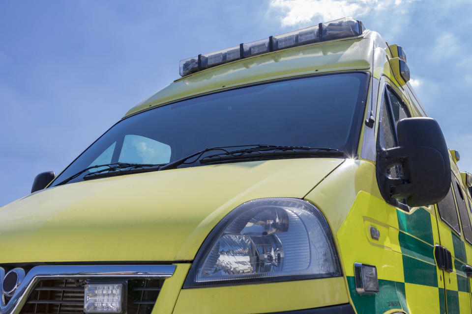 Yellow and green British Ambulance on a sunny day