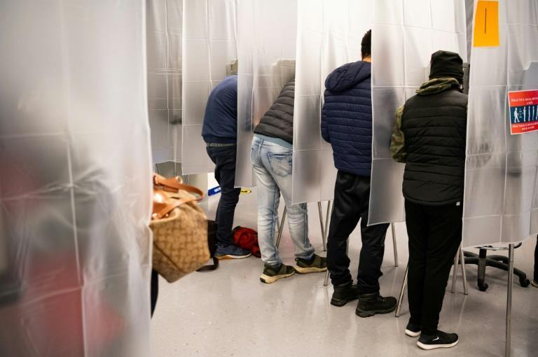 Cleveland, Ohio, voters are seen at an early voting station on October 16, 2020