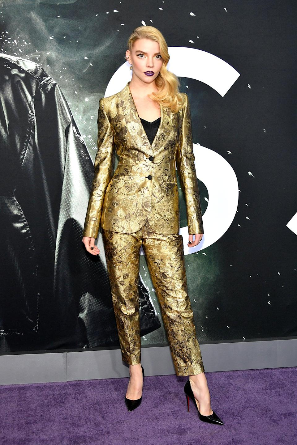 <p>Anya wore a gold Dolce &amp; Gabbana suit, teamed with Christian Louboutin heels and jewelry by Effy and Jemma Wynne.</p>