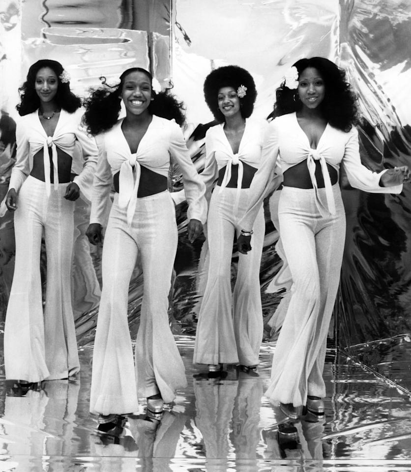 Dressed in all white and ready to slay during a performance in the '70s.