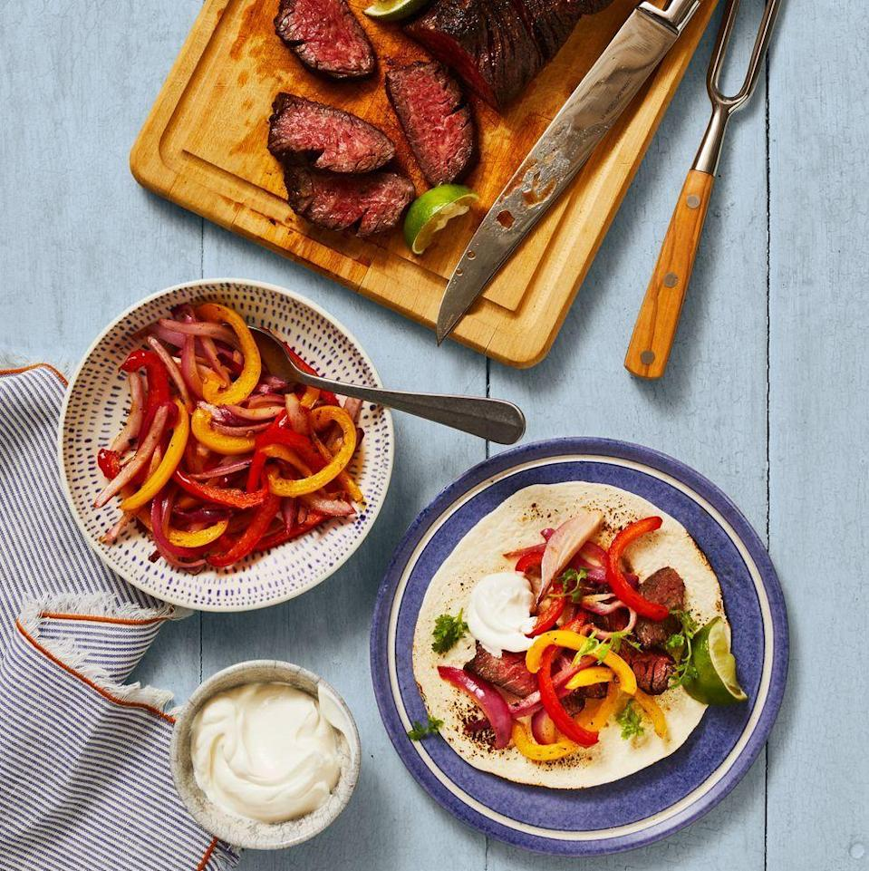 "<p>It's easy to make fajitas in <a href=""https://www.goodhousekeeping.com/appliances/a24630295/best-air-fryers-reviews/"" rel=""nofollow noopener"" target=""_blank"" data-ylk=""slk:the air fryer"" class=""link rapid-noclick-resp"">the air fryer</a>: Season the vegetables and steak, air-fry and serve with toppings. It's restaurant-quality cooking at home!</p><p><em><a href=""https://www.goodhousekeeping.com/food-recipes/a34220896/steak-fajitas-recipe/"" rel=""nofollow noopener"" target=""_blank"" data-ylk=""slk:Get the recipe for Steak Fajitas »"" class=""link rapid-noclick-resp"">Get the recipe for Steak Fajitas »</a></em></p>"