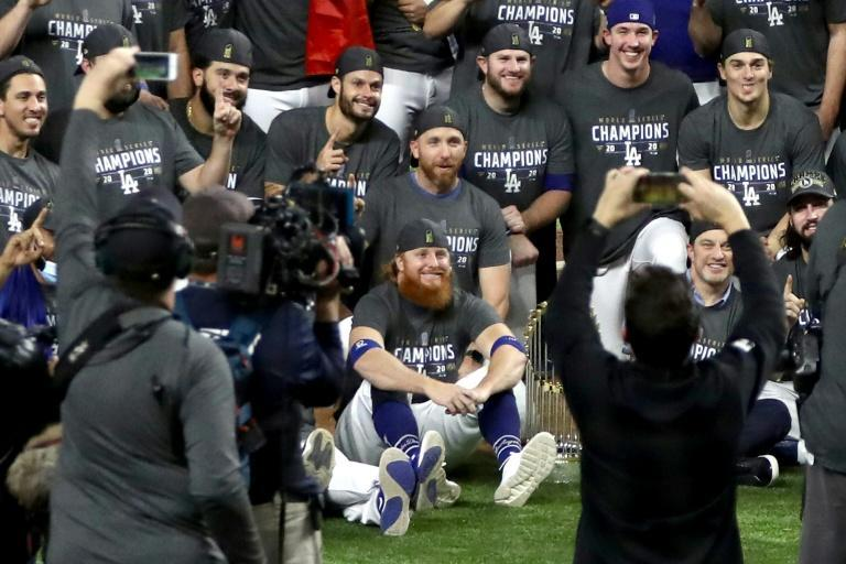 LA Dodgers star Justin Turner sits with team-mates after the World Series victory, despite being told to isolate after a positive Covid-19 case