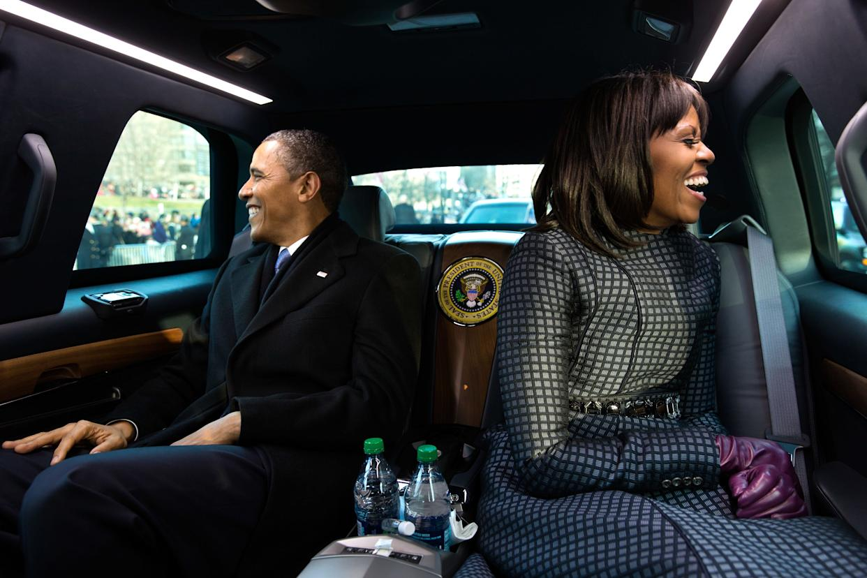 President Barack Obama and first lady Michelle Obama ride in the inaugural parade in Washington on Jan. 21, 2013.