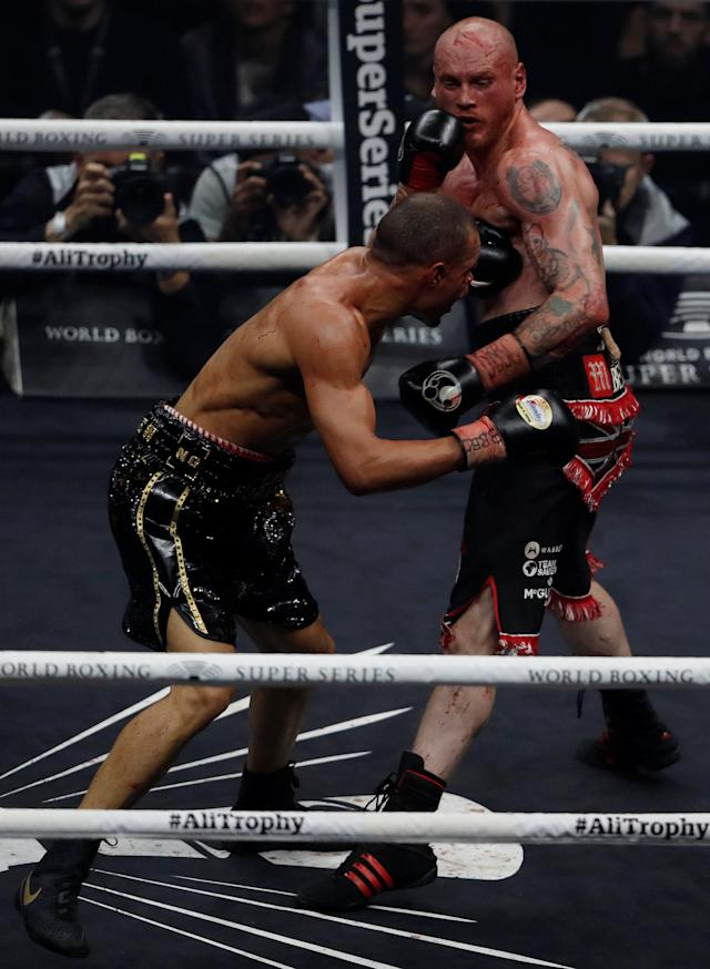 Boxing - World Boxing Super Series Semi Final - George Groves vs Chris Eubank Jr - WBA & IBO World Super-Middleweight Titles - Manchester Arena, Manchester, Britain - February 17, 2018 George Groves in action with Chris Eubank Jr Action Images via Reuters/Lee Smith