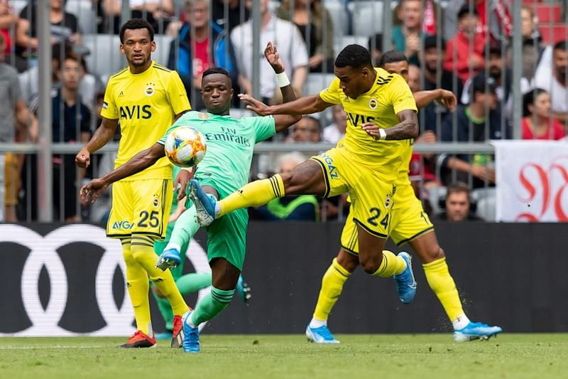 MUNICH, GERMANY - JULY 31: Vinicius Junior of Real Madrid and Garry Rodrigues of Fenerbahce Istanbul battle for the ball during the Audi cup 2019 3rd place match between Real Madrid and Fenerbahce at Allianz Arena on July 31, 2019 in Munich, Germany. (Photo by TF-Images/Getty Images)