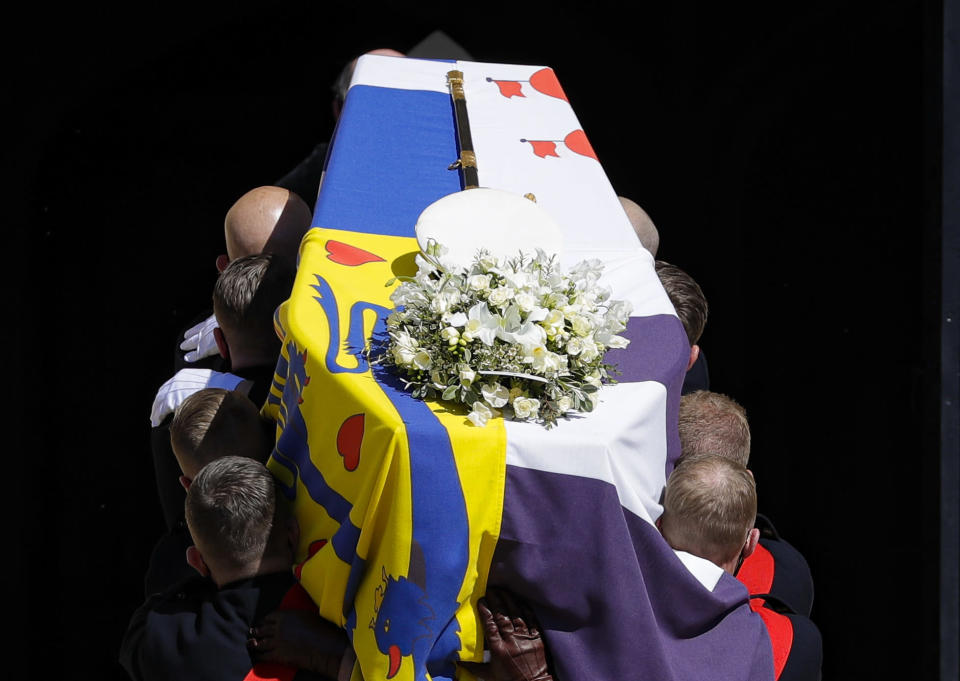The coffin is carried inside the St George's Chapel for the funeral of Britain's Prince Philip inside Windsor Castle in Windsor, England, Saturday, April 17, 2021. (Kirsty Wigglesworth/Pool via AP)