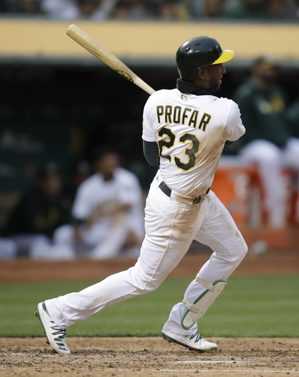 Oakland Athletics' Jurickson Profar swings for a two-run single off Seattle Mariners' Wade LeBlanc in the fourth inning of a baseball game Saturday, June 15, 2019, in Oakland, Calif. (AP Photo/Ben Margot)