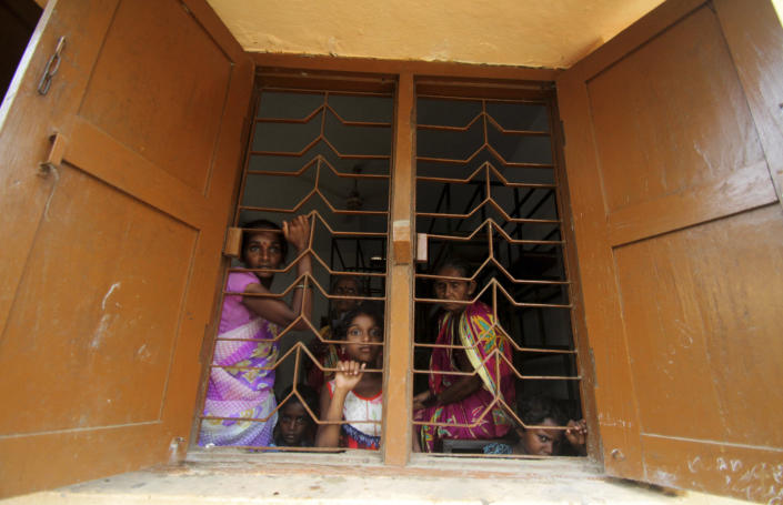 Villagers of Chandrabhaga fishing village take shelter at a government run school building after they were evacuated by the authorities in Puri district of eastern Odisha state, India, Thursday, May 2, 2019. Hundreds of thousands of people were evacuated along India's eastern coast on Thursday as authorities braced for a cyclone moving through the Bay of Bengal that was forecast to bring extremely severe wind and rain. (AP Photo)