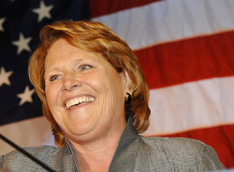 FILE - In this Nov. 6, 2012 file photo, Sen.-elect Heidi Heitkamp, D-N.D., address her supporters in Bismarck, N.D. Despite a proposal backed by over 8 in 10 people in polls, gun control supporters are struggling to win over moderate Democrats like Heitkamp in their drive to push expanded background checks of firearms purchasers through the Senate next month. (AP Photo/Will Kincaid, File)