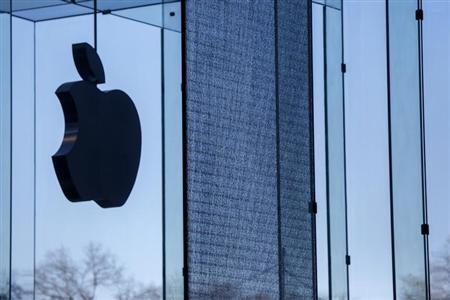 A shattered large glass panel, part of Apple's cube store on Fifth Avenue, damaged from the results of the snowstorm on Tuesday is seen in New York