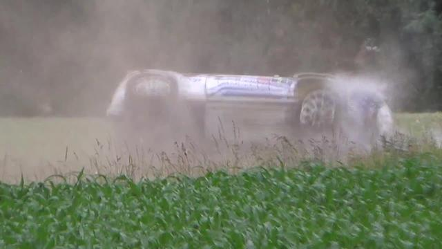 A video has emerged from Belgium of a spectacular crash during a professional rally on Friday. In the video, which was captured in Wijtschate, rally drivers Kevin Abbring and Pieter Tsjoen appear to take a corner too fast and screech around it on two wheels. The vehicle hits a bank by the side of the road and rolls repeatedly before coming to rest in a field. Amazingly, both driver and co-driver escaped without serious injuries. The drivers were competing in the ERC Kenotek Ypres Rally 2015. ---- crash Kevin Abbring - Pieter Tsjoen CREW ok Location (Wijtschate) Belgium