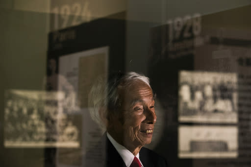 In this July 8, 2019, photo, Kazuo Oda, a son of Mikio Oda, who won Japan's first Olympic gold medal and Asia's first individual gold medal at the 1928 Amsterdam Olympics, smiles during an interview with The Associated Press at Edo-Tokyo Museum in Tokyo. My father was from Hiroshima, so there was a celebration in his hometown upon his return, Kazuo Oda said. But as there were no media possibilities like today, his achievements were not known by everybody in Japan. (AP Photo/Jae C. Hong)
